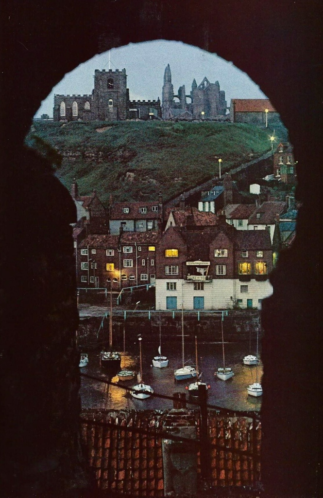 Bleak ruins of an abbey loom above the harbor at Whitby in Yorkshire, England National Geographic   September 1971